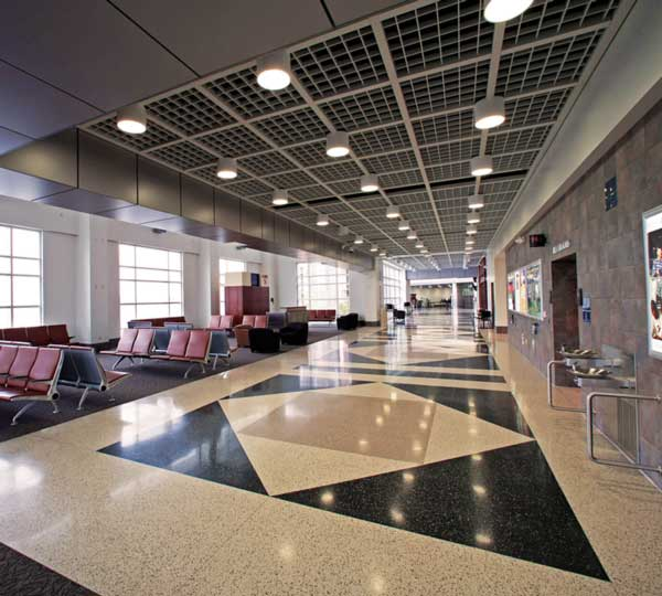 Interior corridor of the Meadows Field Airport terminal. It's very spacious with tan and black marble floor.