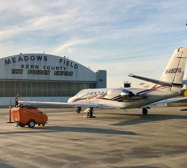 Image of Meadows Field Airport hangar in the daytime